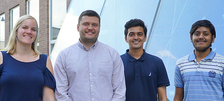 The four pioneering students in the Research Associate Programme
