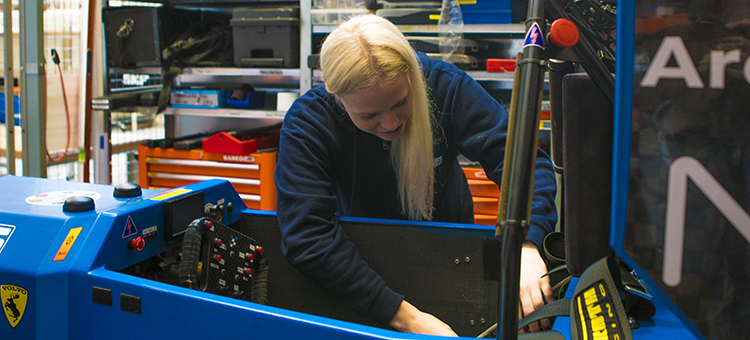 Student with a car in the FormulaStudent project