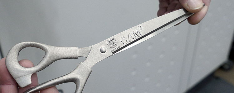 The 3D-printed CAM2 scissors from the centre inauguration