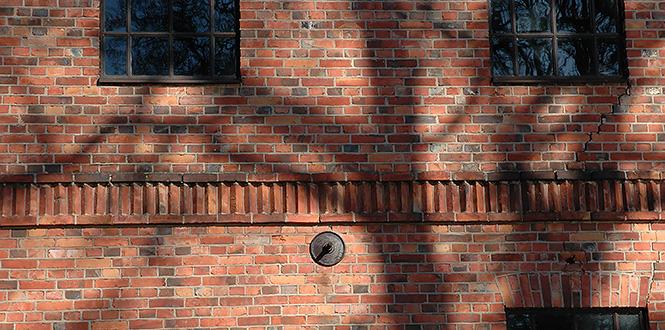 House wall of red brick