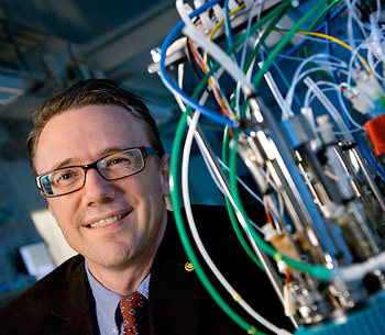 Jens Nielsen next to a bioreactor in the lab.