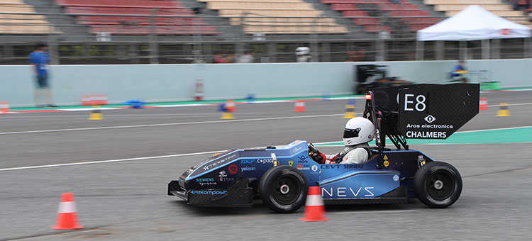 The Formula Student car drives at the racetrack