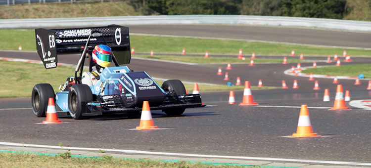 The Formula Student car drives between cones.