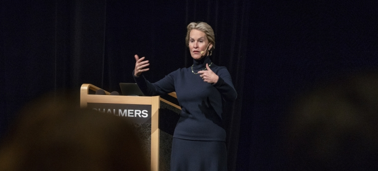 Audio description: Image of Frances Arnold on stage during her lecture.