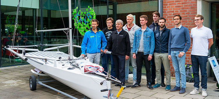 Parts of the crew posing in front of the finished boat.