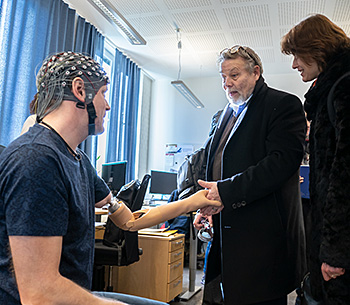 WASP visit to Chalmers BNL lab. Hand shake with patient with muscle and nerve prosthesis.