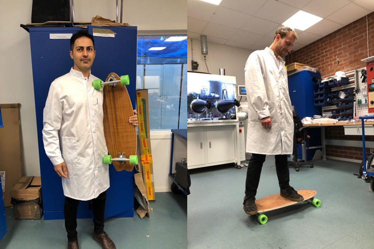 Researcher showing skateboard made of ramie/jute Fibre composite with wood core