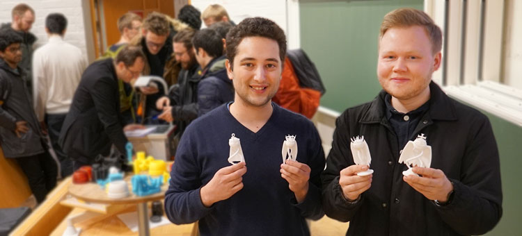 Two male students showing their 3d-printed products