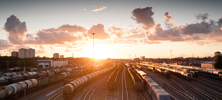 Visual interpretation: Trains and tracks in sunset