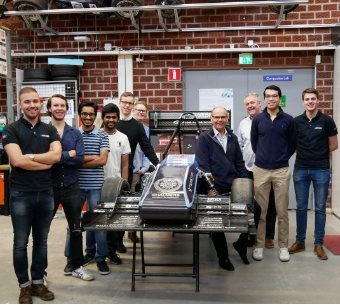 ​Willem Toet sitting on the Chalmers formula student car from 2018.